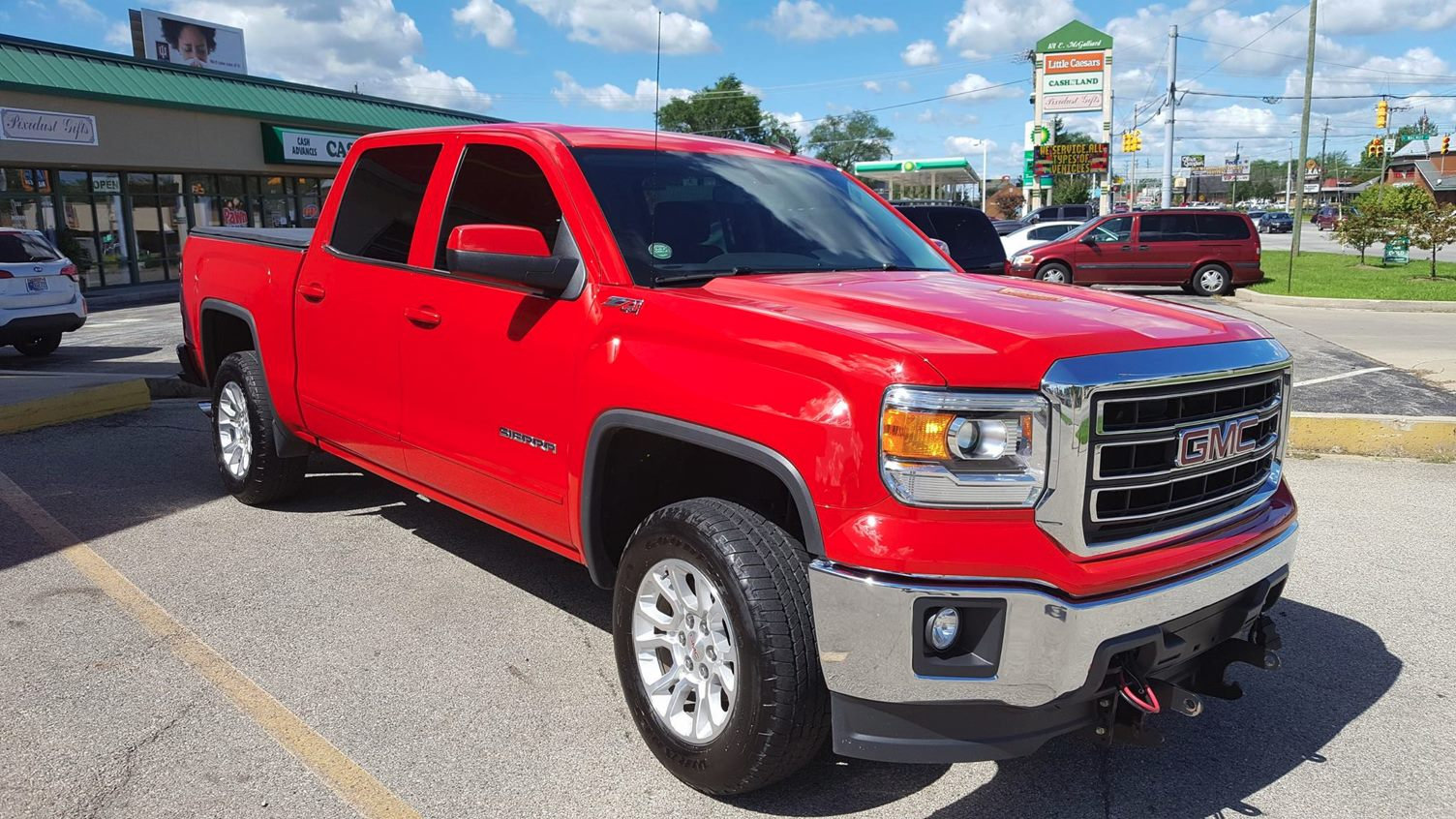Red GMC Sierra with Diamond Gloss
