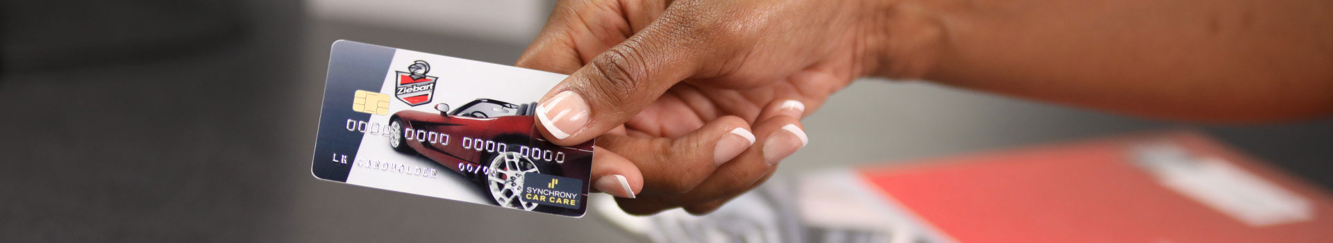 Hands holding a Ziebart credit card